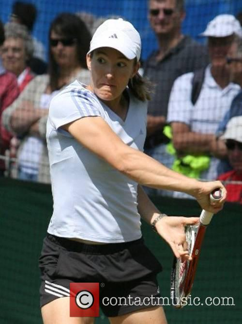 Justine Henin (BEL) The Number one seed warms...