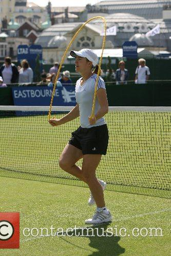 Warms up before her match against Amelie Mauresmo...