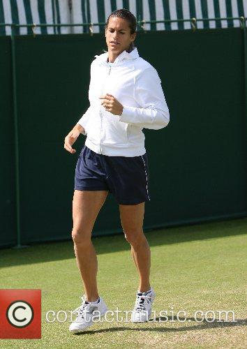 Warms up before her match against Justine Henin...