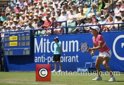 Justine Henin plays the final game in her...