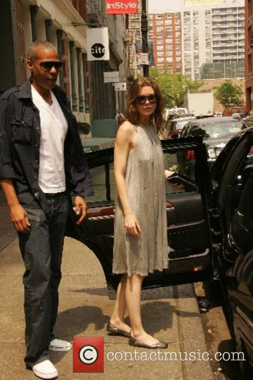 Ellen Pompeo and her fiance Christopher Ivery leave...