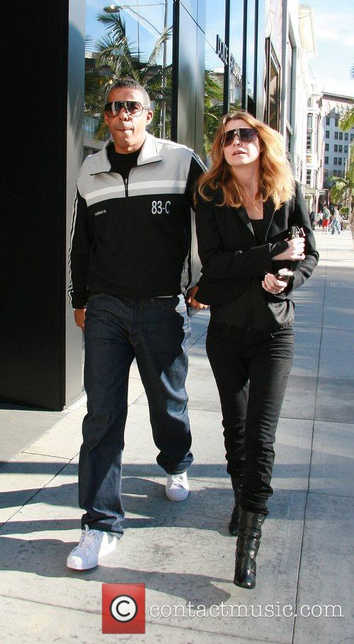 Ellen Pompeo with her husband Christopher Ivery walking...