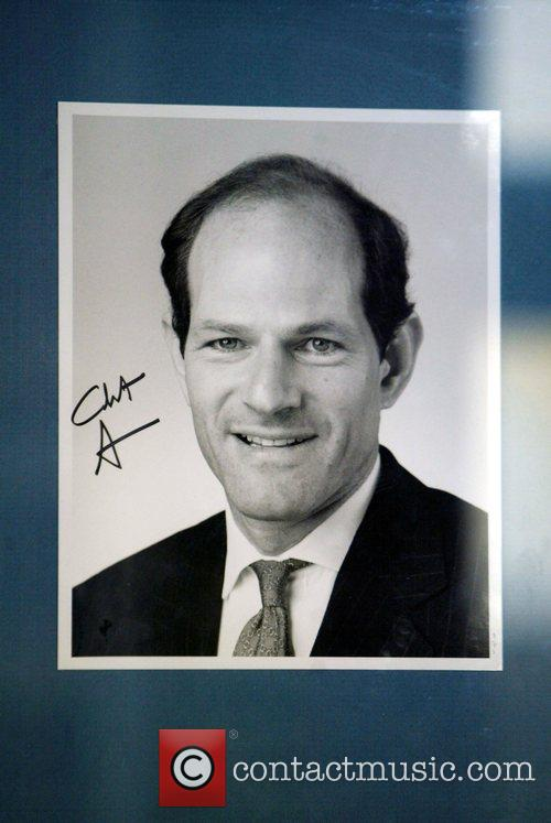 Autographed portrait of disgraced former governor Elliot Spitzer...