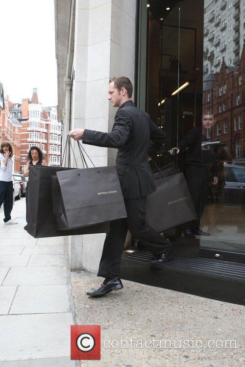 Elton John's shopping from Bottega Veneta is carried...