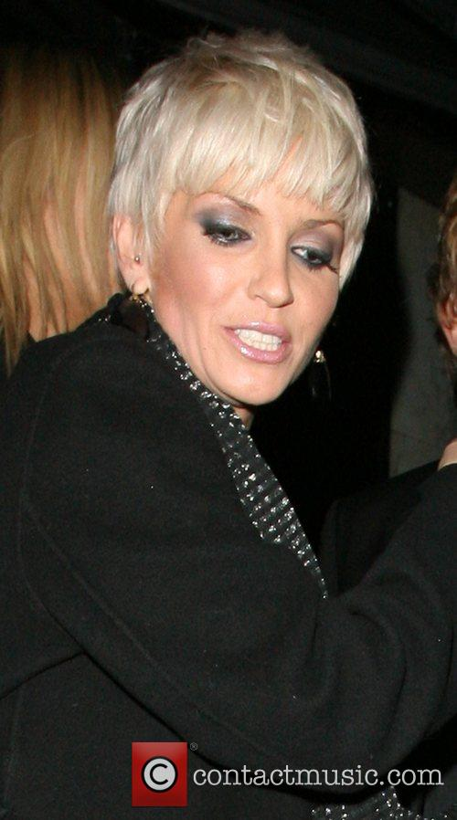 Sarah Harding leaves the Embassy Club, and heads...