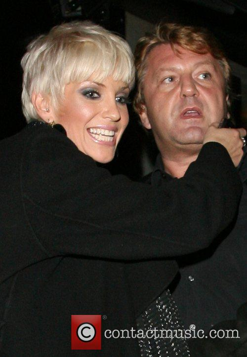 Sarah Harding hugs the manager of Embassy Club...