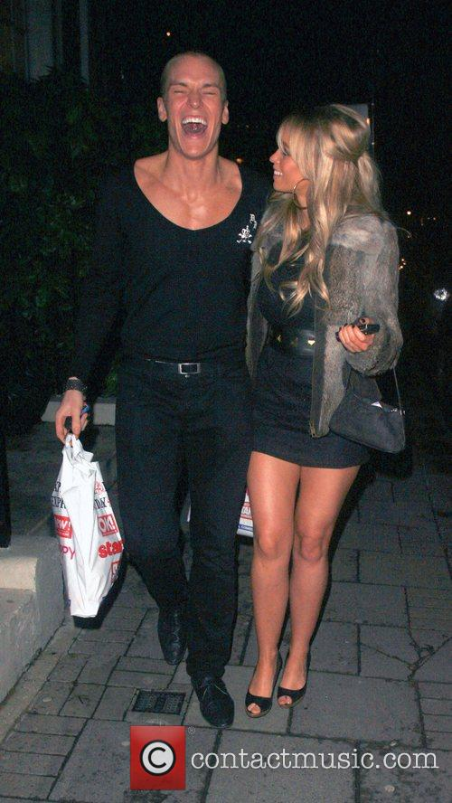 Lauren Pope and mystery man at the Embassy...