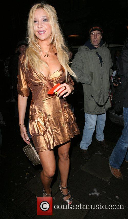 Alicia Douvall leaving the OK Magazine New Year...