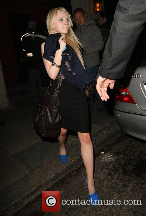 Evanna Lynch leaving Emma Watson's 18th birthday party...