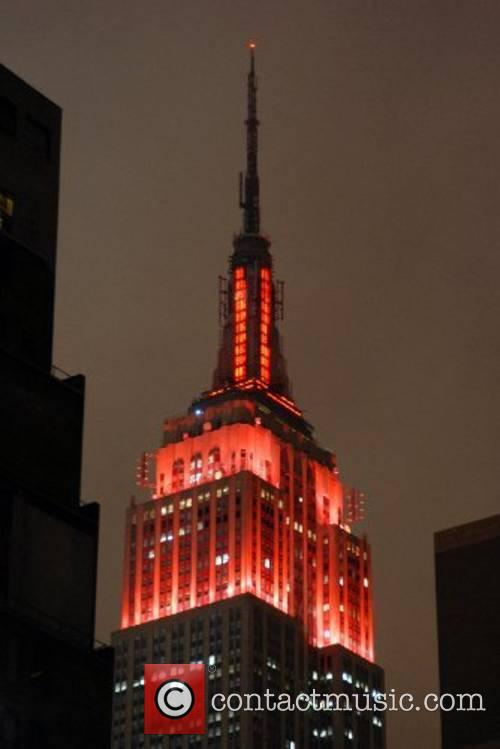 Empire State Building is illuminated in scarlet red...
