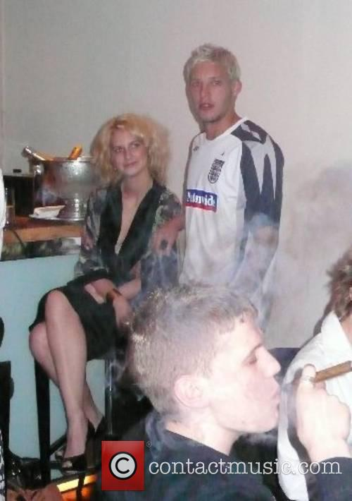 Alan Smith with a mystery blonde Members of...