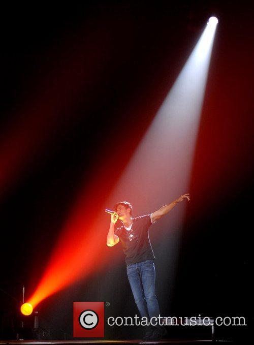Performing live at Wembley Arena