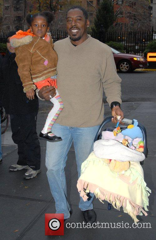 Ernie Hudson with his daughter leaving their midtown...