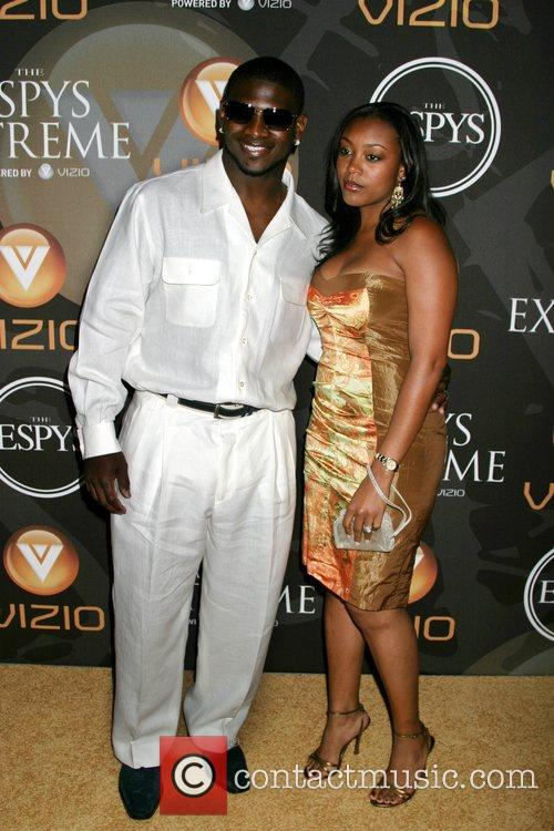 NFL football player LaDainian Tomlinson and his wife...