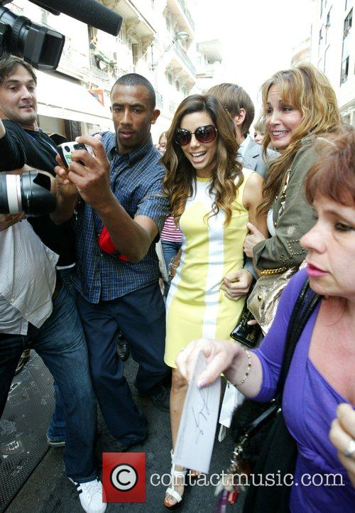 Mobbed by fans as she leaves 'Mercedia' shoe...
