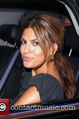 Eva Mendes rolls down her window while she...