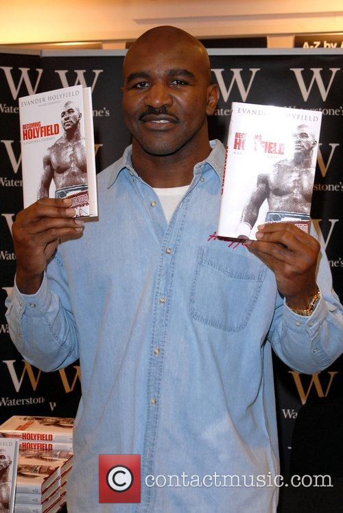 Evander Holyfield signs copies of his new book...