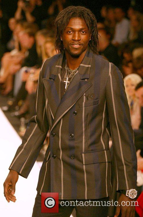 Emmanuel Adebayor Fashion For Relief at the Natural...