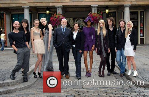 Colin McDowell pictured with a host of models...