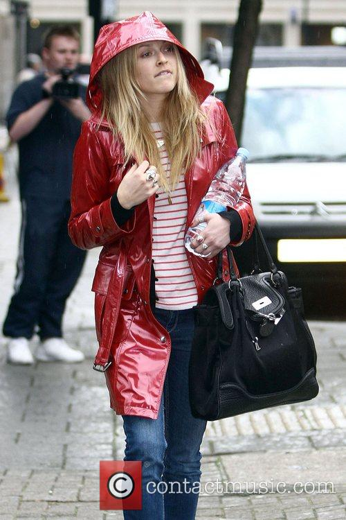Fearne Cotton braves the rain as she leaves...