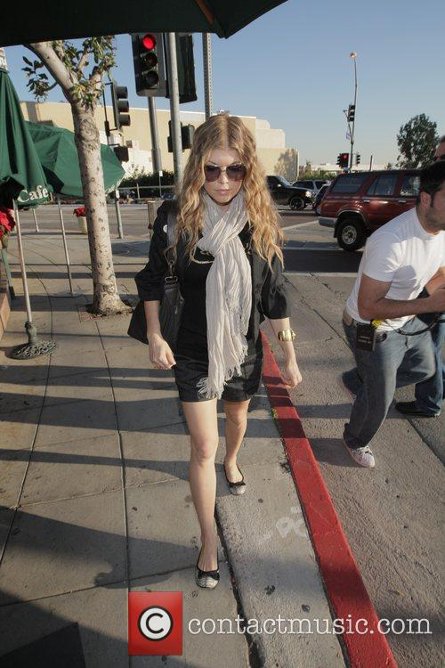 Fergie (Stacy Ferguson) of Black Eyed Peas, leaves...