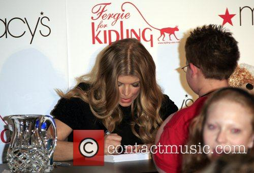 Signs her handbag collection 'Fergie for Kipling' at...