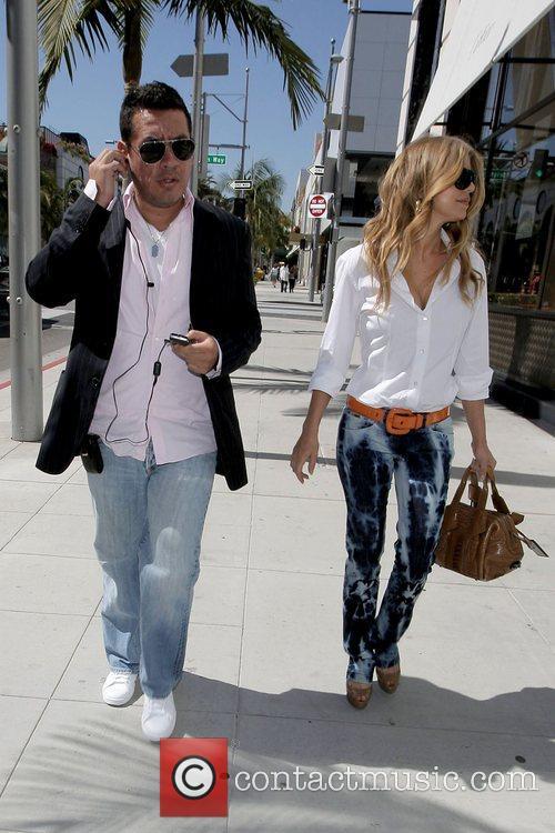 Fergie (aka Stacy Ann Ferguson) walks along Rodeo...