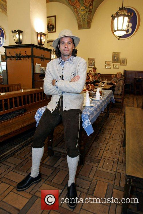In a traditional Bavarian outfit with Lederhosen at...