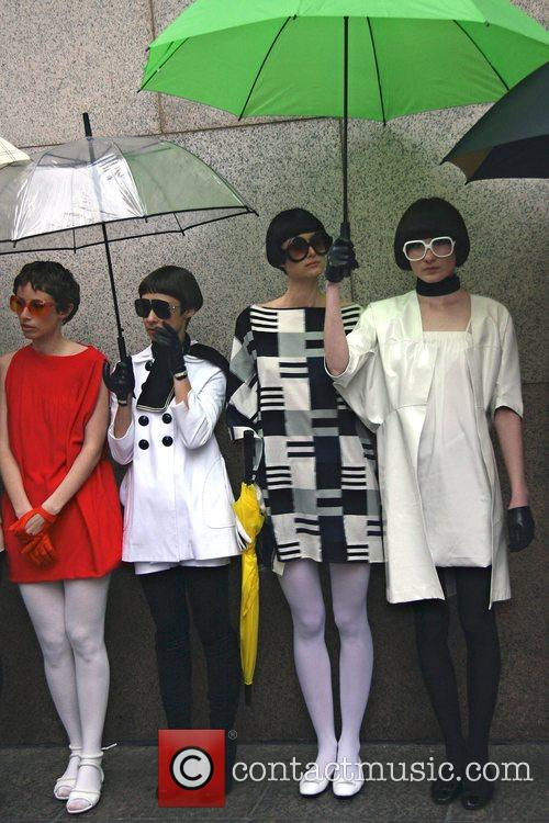 Models walk and pose with umbrellas along Manhattan's...