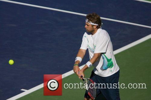 Mardy Fish and David Nalbandian play in a...