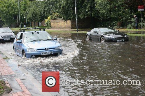 An Aston Martin caught in the floods on...