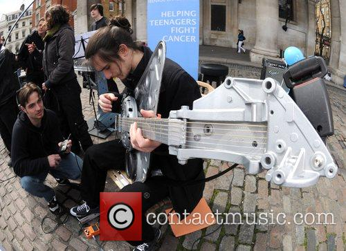 Members of the Ford Car Part orchestra busk...