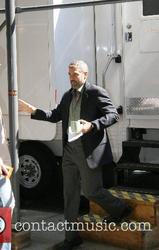 George Clooney at his trailer after filming a...