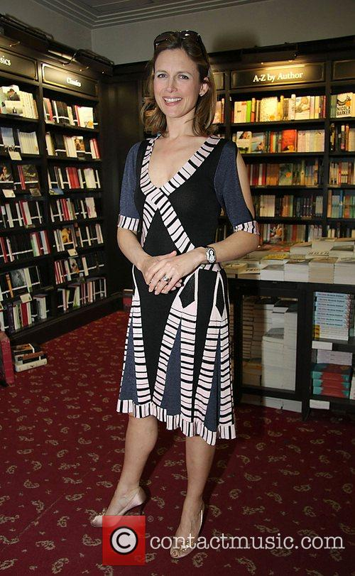 Katie Derhan attends the book signing session of...