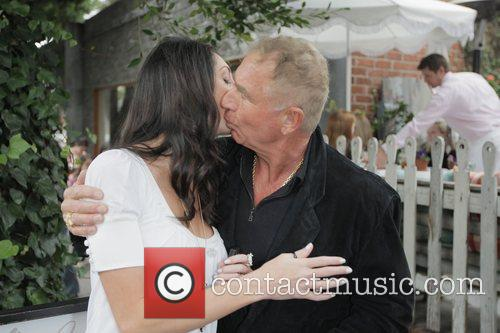Frederick Prinz von Anhalt kisses model Ashley Chase...