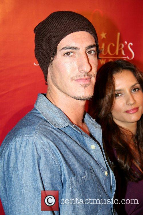Eric Balfour and Guest Frederick's of Hollywood 2008...