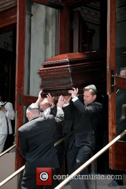 Claudia Cohen's casket is carried out of Central...