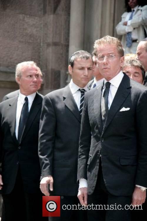 Michael Gelman and Calvin Klein depart the funeral...