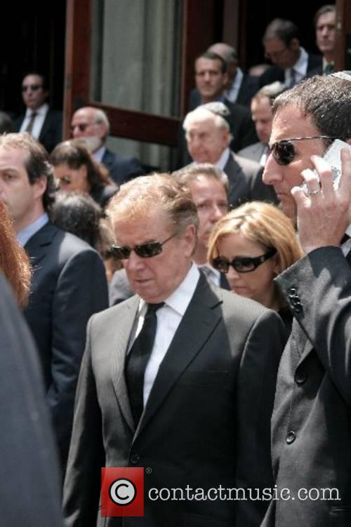 Regis Philbin and Michael Gelman depart the funeral...