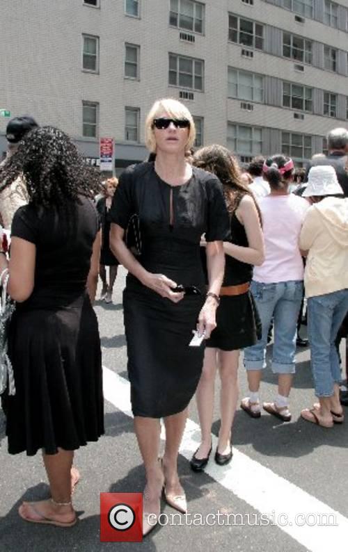 Ellen Barkin departs the funeral of Claudia Cohen...
