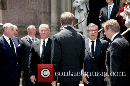 Bob Colacello and Regis Philbin depart the funeral...