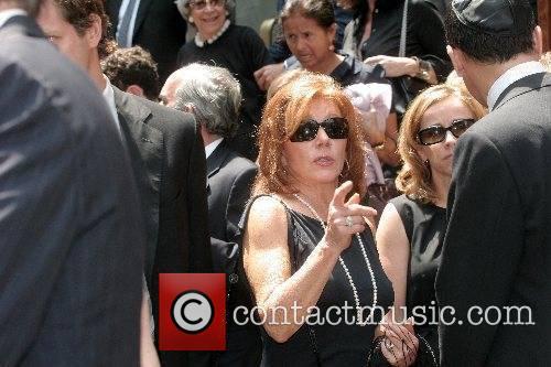 Joy Philbin departs the funeral of Claudia Cohen...