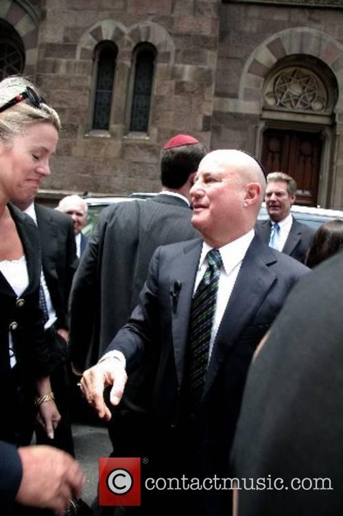 Ron Perelman and Deborah Norville depart the funeral...