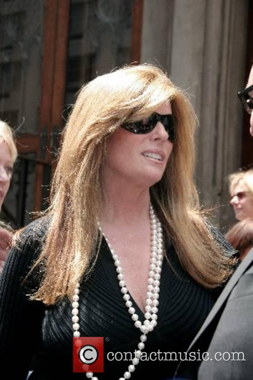 Jill Rappaport and guests depart the funeral of...