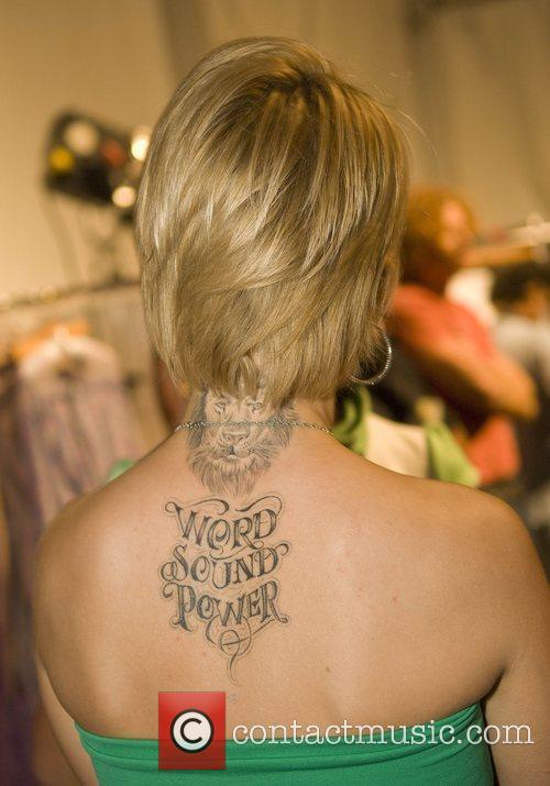 Actress Mena Suvari shows tattoos on her neck...