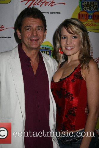 Adrian Zmed and guest at the 'American Game...
