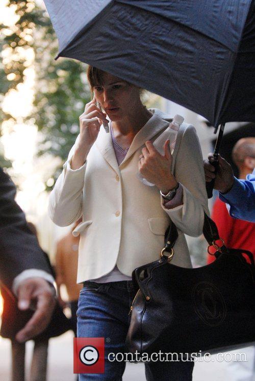 Jennifer Garner talking on her phone while trying...