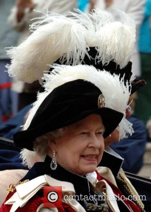Queen Elizabeth ll leaves in an open carriage...