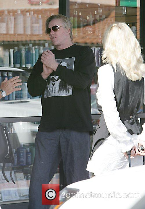 Gary Busey talking a to a lady outside...