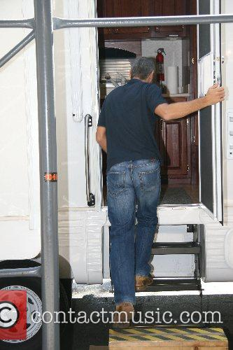 Walks back to his trailer after filming a...